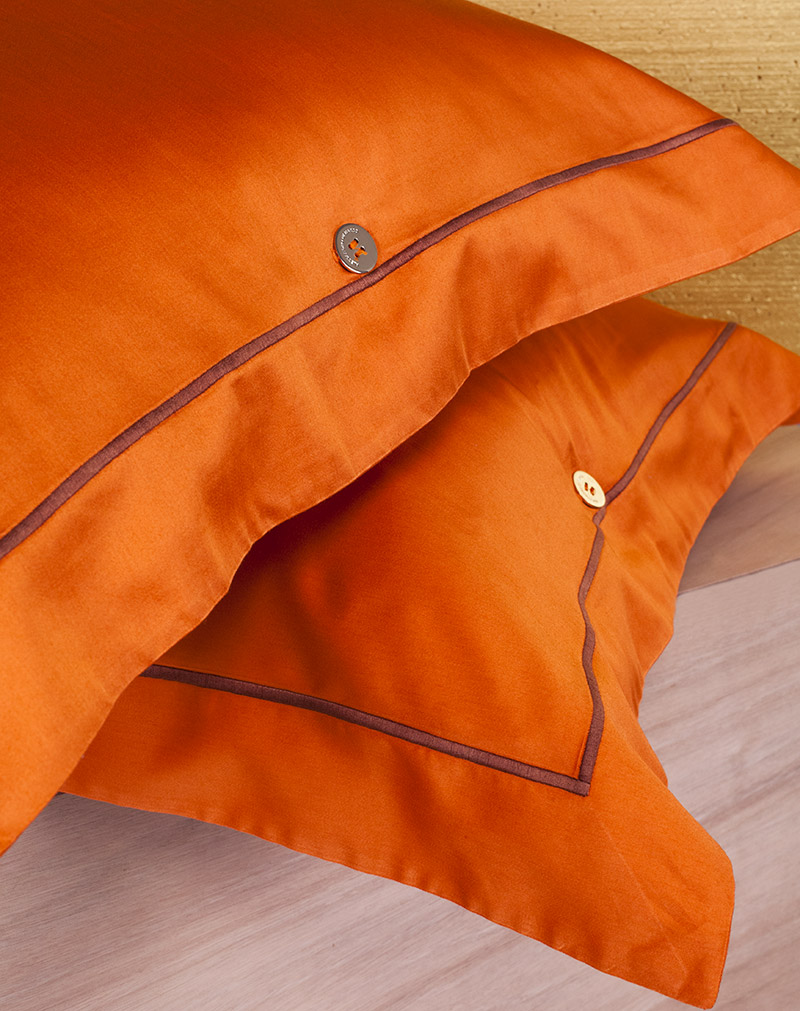 Orange embroidered pillowcases alessandro di marco for Is higher thread count better